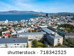 Beautiful super wide-angle aerial view of Reykjavik, Iceland with harbor and skyline mountains and scenery beyond the city, seen from the observation tower of hallgrimskirja