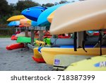 many kayaks on a rack on the... | Shutterstock . vector #718387399
