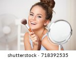gorgeous young brunette woman... | Shutterstock . vector #718392535