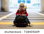 a young caucasian boy in red... | Shutterstock . vector #718405609