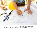 team of construction engineer... | Shutterstock . vector #718442095