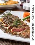 delicious medium marbled steak... | Shutterstock . vector #718452319