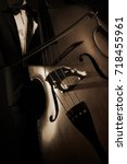 Small photo of Double bass player contrabass. Bow cello string musical instrument
