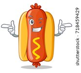 wink hot dog cartoon character | Shutterstock .eps vector #718459429