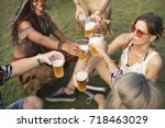 group of friends drinking beers ... | Shutterstock . vector #718463029