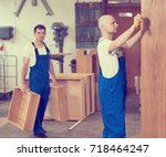 two worker in blue dungarees in ... | Shutterstock . vector #718464247