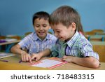 lesson. little schoolboys are...   Shutterstock . vector #718483315