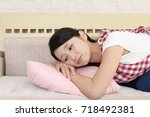 tired asian housewife | Shutterstock . vector #718492381