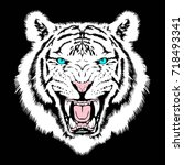 angry tiger face | Shutterstock .eps vector #718493341