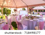 served round banquet table... | Shutterstock . vector #718498177