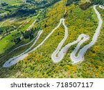 winding road on mountains near... | Shutterstock . vector #718507117