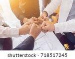 asian businessman with hands... | Shutterstock . vector #718517245