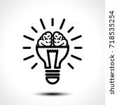 logo with a half of light bulb... | Shutterstock .eps vector #718535254