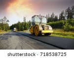steamrollers paving a newly... | Shutterstock . vector #718538725
