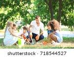 group of children with teacher... | Shutterstock . vector #718544527