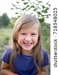 young little girl without a...   Shutterstock . vector #718548025
