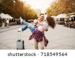 happy couple enjoys at streets... | Shutterstock . vector #718549564
