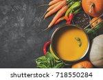 creamy pumpkins soup with... | Shutterstock . vector #718550284
