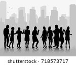 silhouette of a crowd of people ... | Shutterstock . vector #718573717