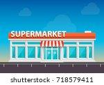 supermarket on the roadside art.... | Shutterstock .eps vector #718579411