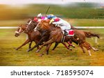 race horses with jockeys on the ... | Shutterstock . vector #718595074