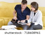 young couple setting the budget | Shutterstock . vector #718608961