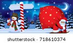 santa claus carrying a big red... | Shutterstock .eps vector #718610374