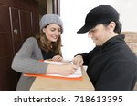 courier delivering a package to ... | Shutterstock . vector #718613395