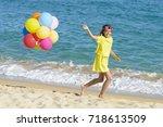 happy girl running on a beach ...   Shutterstock . vector #718613509