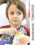 cute little boy eating fried...   Shutterstock . vector #718613515