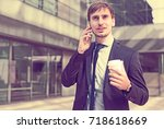 portrait of cheerful male... | Shutterstock . vector #718618669