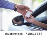 the seller of cars transfers... | Shutterstock . vector #718619854