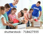 happy volunteers with children... | Shutterstock . vector #718627555