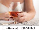 drunk woman holding an... | Shutterstock . vector #718630021