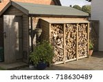 log store standing against a... | Shutterstock . vector #718630489