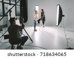professional photographer ... | Shutterstock . vector #718634065