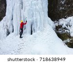 a young climber climbs on ice... | Shutterstock . vector #718638949