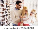 Happy Family Choosing Glasses...