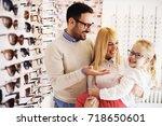 happy family choosing glasses... | Shutterstock . vector #718650601