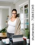 confident pregnant woman... | Shutterstock . vector #718651345