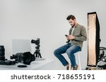 professional male photographer... | Shutterstock . vector #718655191
