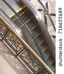 generic mall escalator | Shutterstock . vector #718655689