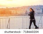 a beautiful young woman running ...   Shutterstock . vector #718660204