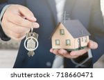 real estate agent with home...   Shutterstock . vector #718660471