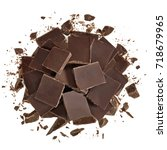broken dark chocolate pieces... | Shutterstock . vector #718679965