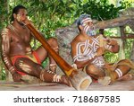 Small photo of KURANDA, AUSTRALIA - NOVEMBER 07, 2007: Unidentified aborigine actors perform music with traditional instruments in the Tjapukai Culture Park in Kuranda, Queensland, Australia.