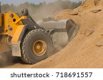 frontal excavator pushing a... | Shutterstock . vector #718691557
