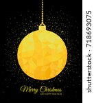 gold christmas ball on black...