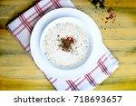 plate soup or yoghurt soup  ... | Shutterstock . vector #718693657