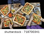 cutting pizza. domestic food... | Shutterstock . vector #718700341